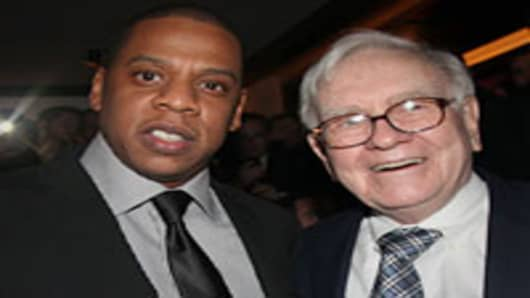 Jay-Z and Warren Buffett attend the grand re-opening of Jay-Z's 40/40 Club.