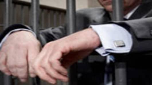 businessman-jail-140.jpg