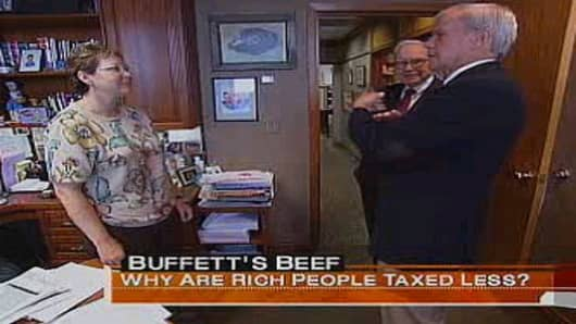 Warren Buffett's assistant Debbie Bosanek speaks with NBC's Tom Brokaw in this frame grab from a 2007 report on Buffett's call for higher taxes on the super-rich.