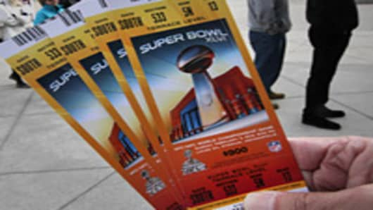 New England Patriots fans wait in line to pick up their Super Bowl tickets at Gillette Stadium.