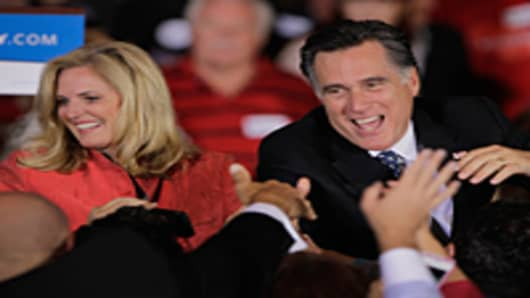 Mitt Romney and his wife Ann greet people during his Florida primary night party January 31, 2012 in Tampa, Florida.