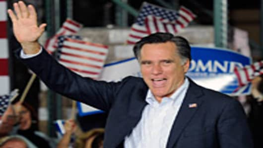 Mitt Romney waves during a campaign rally at Brady Industries February 1, 2012 in Las Vegas, Nevada.