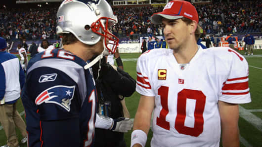 New England Patriots quarterback Tom Brady with New York Giants quarterback Eli Manning