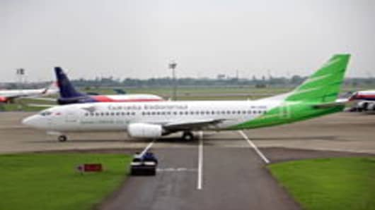 A Citilink aircraft, the low-cost unit of PT Garuda Indonesia, taxis at Soekarno-Hatta International Airport in Cengkareng, near Jakarta, Indonesia, on Thursday, Dec. 8, 2011. Garuda is the nation's biggest carrier. Citilink expects to almost triple sales next year as it adds new planes and benefits from domestic economic growth.