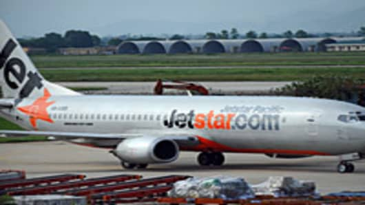 Low-cost airline Jetstar Pacific taxiing at Hanoi's Noi Bai international airport.