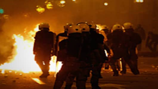 Demonstrators clash with police during the demonstration against the new austerity measures in Syntagma Square.