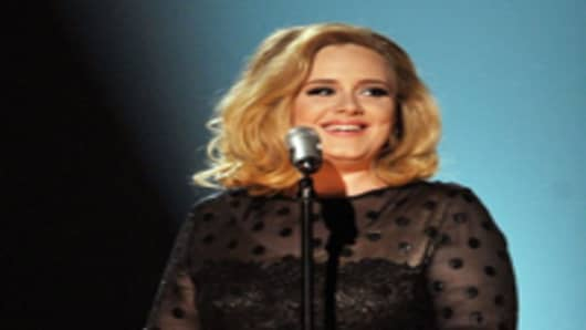 Singer Adele performs onstage at the 54th Annual GRAMMY Awards held at Staples Center in Los Angeles, California.
