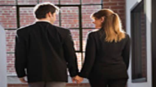 man-and-woman-holding-hands-office-140.jpg