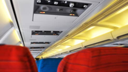 empty-plane-seats-with-overhead-lights_200.jpg
