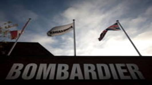 Flags of the United Kingdom, Bombardier Inc. and Canada fly outside Britain's sole remaining railcar factory, operated by Bombardier Inc.