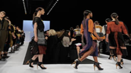 Models walk the runway at the BCBG Max Azria Fall 2012 fashion show during Mercedes-Benz Fashion Week.