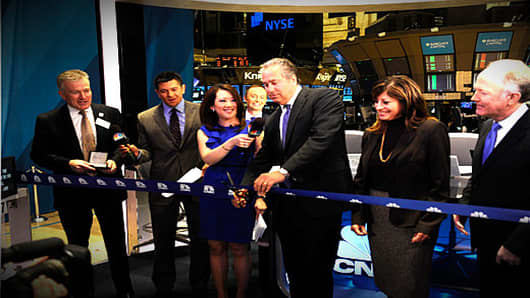 CNBC President Mark Hoffman cuts the ceremonial ribbon to celebrate the opening of CNBC's new presence on the New York Stock Exchange trading floor.
