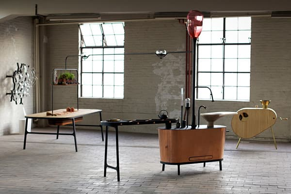 "At first glance, this assemblage of odd furnishings might look like the result of an artist's steampunk whimsy, but in actuality this is a project designed by the Dutch electronics company Philips aiming to address ecological issues of the post-industrial world. ""We need to go back to nature in order to move forward,"" the project's  says. As such, the new take on the larder, pictured at far left, is designed to store fresh ""living"" food without refrigeration. The island at the center is a methan"