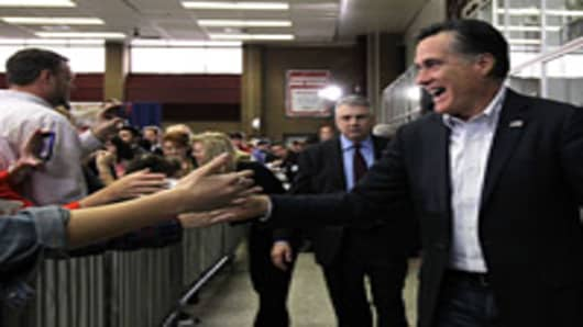 Republican presidential candidate, former Massachusetts Gov. Mitt Romney greets supporters during the Snellville pancake brunch at Brookwood High School on March 4, 2012 in Snellville, Georgia.