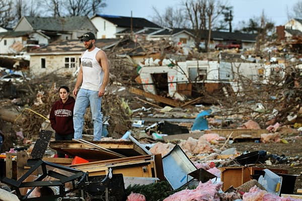 Josh Summers and his wife Lindsey search for their possessions after a tornado ripped through their neighborhood in the early morning hours of February, 29, 2012 in Harrisburg, Illinois.