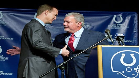 Peyton Manning and Indianapolis Colts owner Jim Irsay hug during a press conference announcing that the Colts will release Manning in Indianapolis, Indiana.