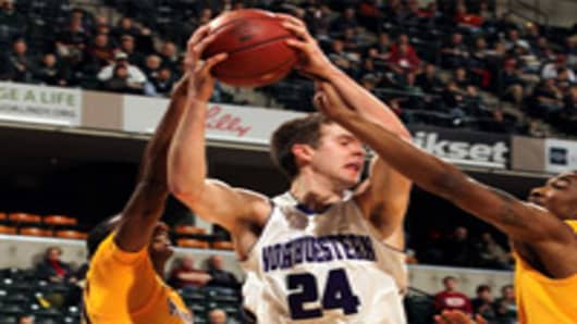 John Shurna #24 of the Northwestern Wildcats attempts to control the ball against Andre Ingram #30 of the Minnesota Golden Gophers during their first round game of 2012 Big Ten Men's Basketball Conferene Tournament.