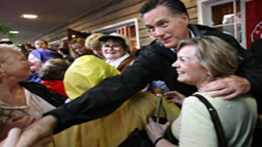 Republican presidential candidate, former Massachusetts Gov. Mitt Romney greets supporters during a campaign stop at the Whistle Stop cafe March 12, 2012 in Mobile, Alabama.