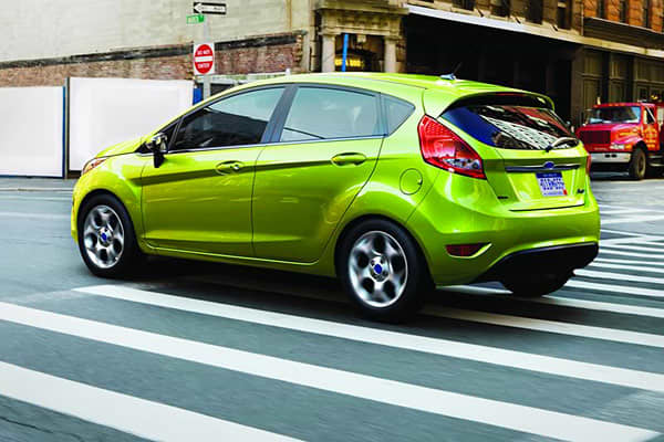 """Starting Price: $13,320Fuel Economy: Up to 40 mpgTotal Car Score 77.07The Ford Fiesta has the distinction of the lowest starting price on this list. It's available as a compact four-door sedan or a five-door hatchback. Brauer says the car's """"sporty handling and edgy exterior inject emotion into this traditionally stodgy category."""" Also in its favor are  like its fuel-efficient engine and technological features like Ford's Sync multimedia interface."""