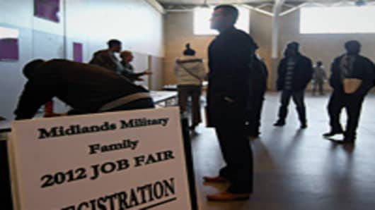 Job applicants register at a military job fair for National Guardsmen, veterans and their families.