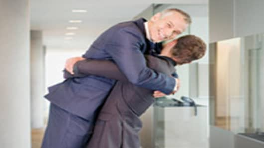 businessmen-hugging-200.jpg