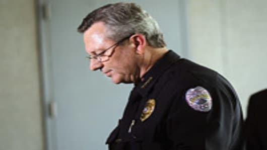 Sanford Police Department Chief Bill Lee (L) speaks while announcing he will temporarily step down in the wake of the Trayvon Martin killing as Sanford city manager Norton Bonaparte Jr. (R) stands by on March 22, 2012 in Sanford, Florida.