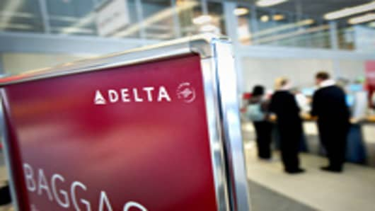 Passengers check in for Delta Air Lines