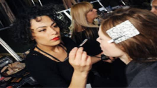 M.A.C.'s senior artist of Brazil, Fabiana Gomes, applies makeup on a model.
