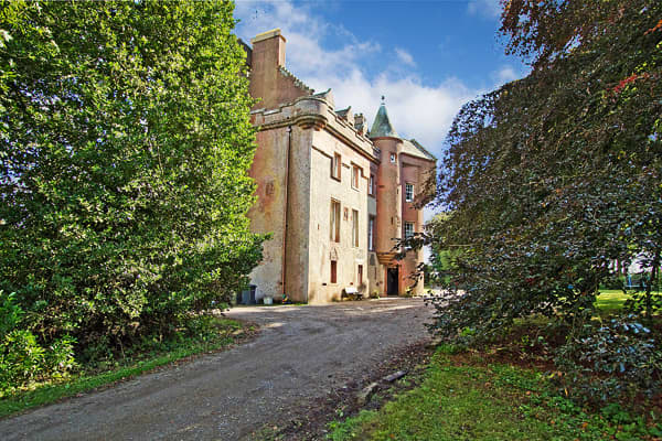 Price: £650,000 (USD $1,038,834)Bedrooms: 10Bathrooms: 3Square Footage: 9230Grounds: 10.65 acresOne of the older castle homes in this list, Colliston Castle was erected in 1545 on the grounds of a mansion house granted to John Guthrie and Isabella Ogilvy by Cardinal David Beaton of Arbroath Abbey in 1539. Set in more than 10 acres of gardens and woodland in keeping with its era  has a number of period features such as the original castle front door leading into the hallway with stone floor and b