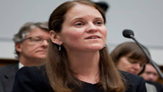 Edith O'Brien, former assistant treasurer with MF Global Inc., invokes her Fifth Amendment right during a House Financial Services subcommittee hearing in Washington, D.C., U.S., on Wednesday, March 28, 2012.