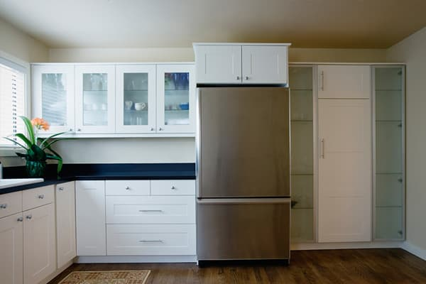 """Remodeling rule: Fewer homeowners are transforming kitchens into showrooms. Consumers instead are focused on functionality such as expandable, roomy shelving and storage that can store bulk items from your favorite wholesaler. """"Kitchens that had more islands than the Caribbean are resolving themselves into nautical efficiency,"""" Dickinson writes in his book."""