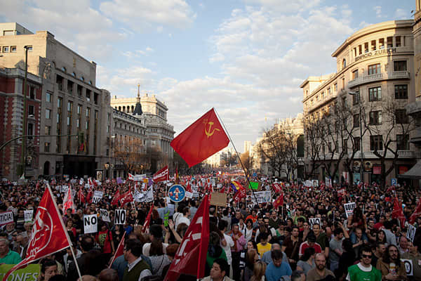 Demonstrators crowd Cibeles Square during a general strike on March 29, 2012 in Madrid, Spain. Spanish workers staged a general strike to protest against the government's new labour reforms and austerity measures.