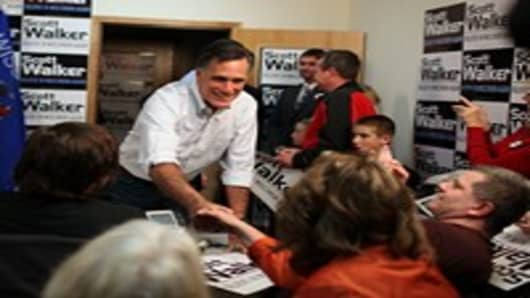 Mitt Romney greets volunteers at a phone bank for Wisconsin Gov. Scott Walker.