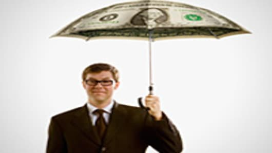 Man holding money umbrella