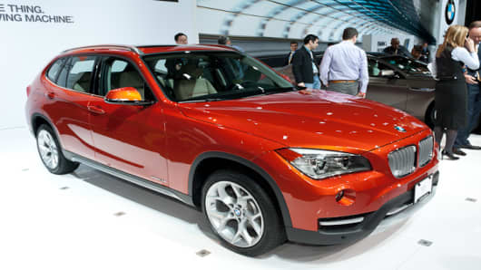 Though it could be considered the X3's little brother, the X1, manufactured in Germany, will finally make it to dealers in the United States this fall. It rivals the Audi Q3, Acura RDX, Infiniti EX and the Land Rover Evoque. Before arriving to the United States, the X1 will receive a minor facelift, and some engine pampering. Other changes include new headlights, new interior surfaces and a center console cup holder. The base X1, the rear-wheel drive sDrive28i will be powered by a 240 horsepower