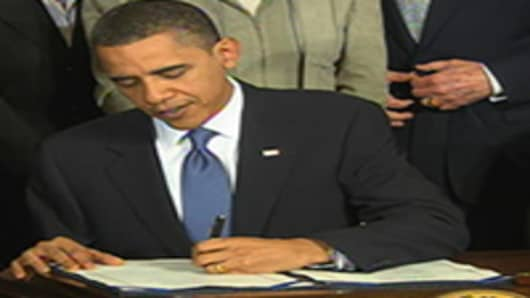 President Obama signing the Affordable Care Act on March 23, 2010