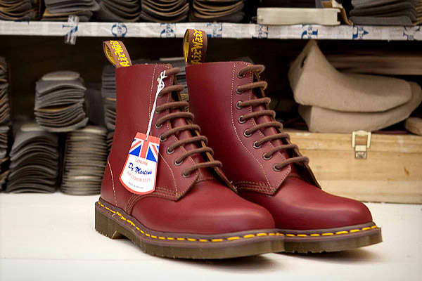 """Dr. Martens is a brand of footwear known for its yellow stitching and patented air-cushioned soles. The brand was adopted by British punk rockers in the 1970s, but went mainstream during the grunge movement of the 1990s. As with all things fashion, the brand eventually fell out of favor and the company was forced to downsize in the face of declining sales. It even  in the U.K. and moved those operations to China.In 2007, Dr. Martens reintroduced the Dr. Martens """"Vintage"""" line, which was basicall"""