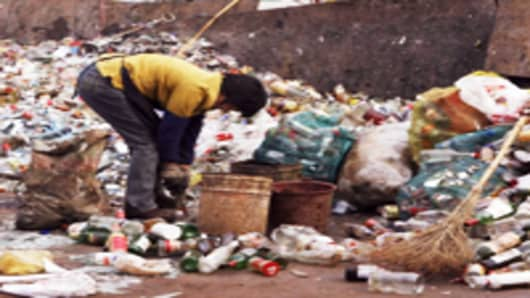 A woman sorts trash at a dump site in Changsha, in China's central province of Hunan.