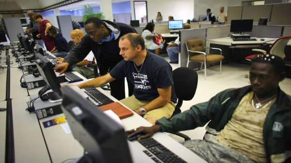 The unemployed look for job opportunities at the South Florida Workforce center in Miami, Florida.