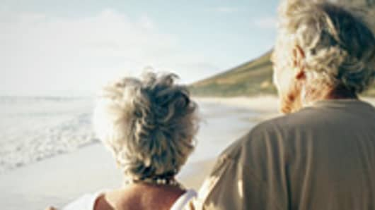 retired-couple-on-beach-200.jpg