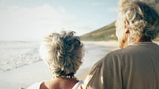 retired-couple-on-beach-200.jpg