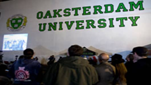 People attend a rally in support of a proposal to legalize marijuana outside Oaksterdam University in Oakland, California, U.S., on Tuesday, Nov. 2, 2010.