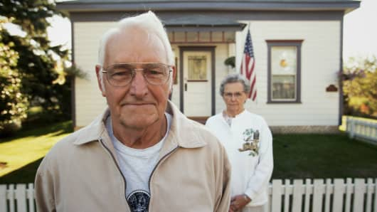retired-couple-in-front-home-200.jpg