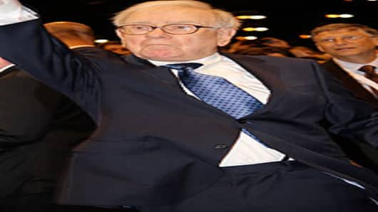 "Warren Buffett participates in his ""Newspaper Toss Challenge"" before today's Q&A session with shareholders.  Buffett delivered newspapers as a boy and prides himself on his accurate tosses."