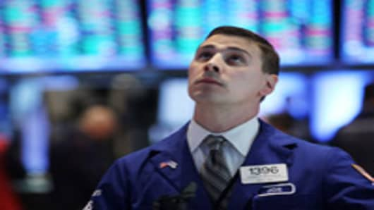 Traders work on the floor of the New York Stock exchange on May 7, 2012 in New York City.Following weekend elections in both France and Greece that showed a growing frustration to German led austerity measures, global markets were shaken with The Dow Jones industrial average losing 39 points, or 0.3% in morning trading