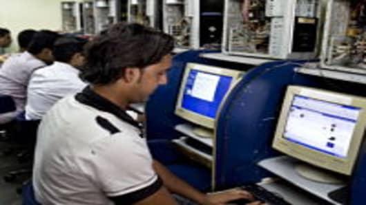 Vijay Singh, 25, checks his Facebook Inc. account at an internet cafe in Mumbai, India.