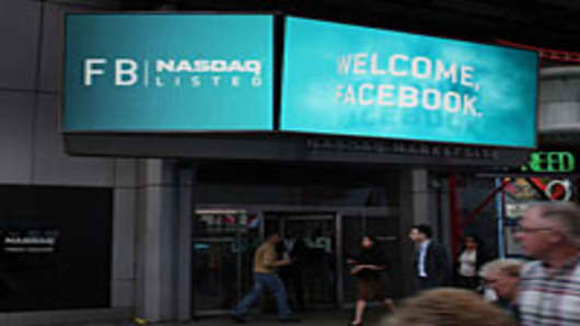 A sign outside of the Nasdaq Marketsite in Times Square welcomes Facebook which is set to debut on the Nasdaq Stock Market.
