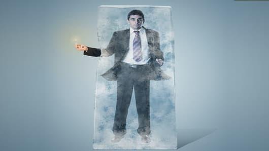 Businessman breaking ice