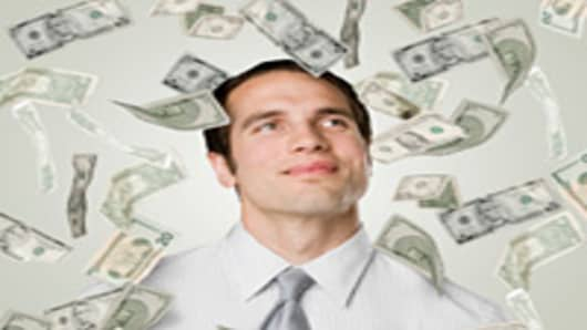 businessman-surrounded-by-floating-money-200.jpg