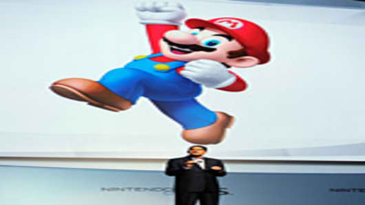 Reggie Fils-Aime, President, Ninyendo America, speaks during a news conference after the unveiling of the new game console Wii U at the Electronic Entertainment Expo on June 7, 2011 in Los Angeles, California.